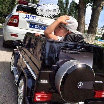 Электромобиль Mercedes-Benz G63 AMG красный глянец (АКБ 12v 7ah, колеса резина, сиденье кожа, пульт, музыка)